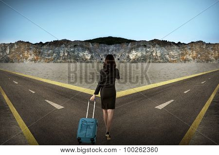 Asian Woman Standing In The Middle Of Cross Road