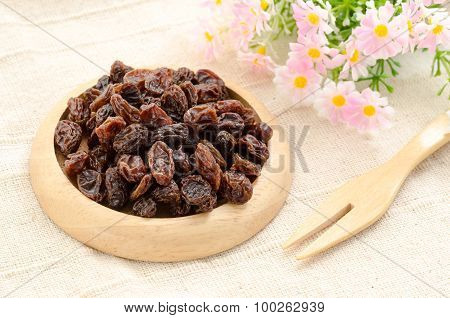 Raisin On Wooden Dish And Wooden Fork Spoon.
