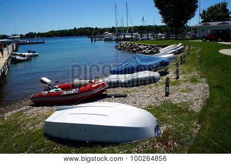 Dinghies Tied On Shore