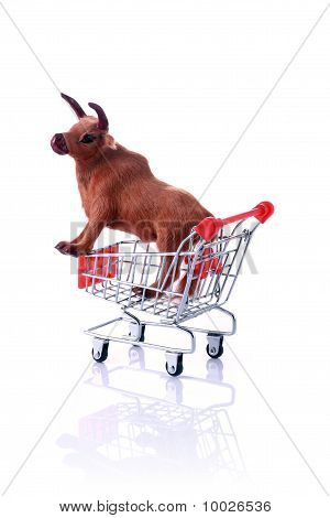 Model Cow In Shopping Cart Isolated