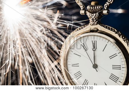 New Year Clock Counting Down And Sparkler