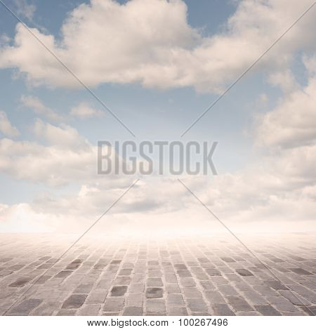cobblestone background with sky on sunset