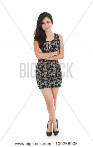 Beautiful young woman wearing a little black dress posing