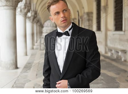 Elegantly dressed young confident man