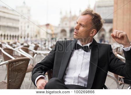 Handsome man sitting in cafe