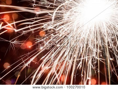 Holiday Background With A Sparkler