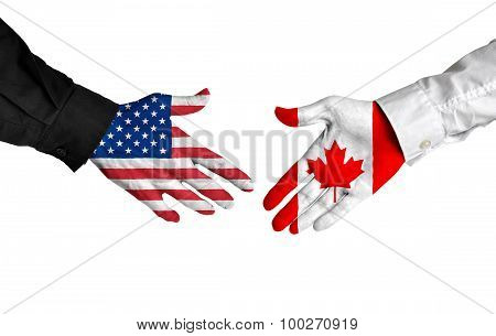 United States and Canada leaders shaking hands on a deal agreement