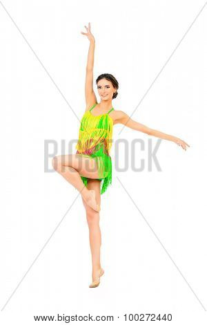 Beautiful professional female dancer dancing at studio. Latin American dances. Isolated over white.