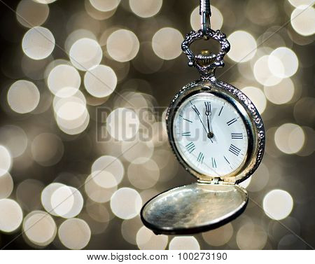 Clock on Glittering Background