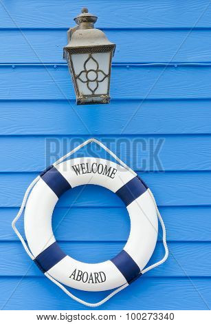 Life Buoy Welcome Aboard Sign And Old Lamp