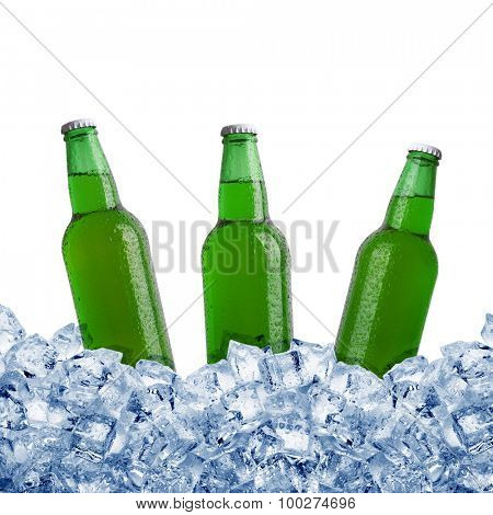 Bottles in ice isolated on white background