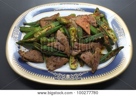Stir fried pork liver with okra, lady's finger