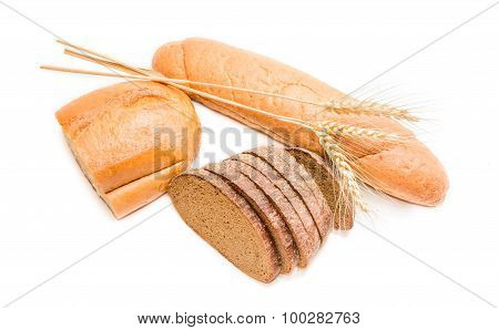 Two Various Loafs Of Wheat Bread, Brown Bread And Spikelets