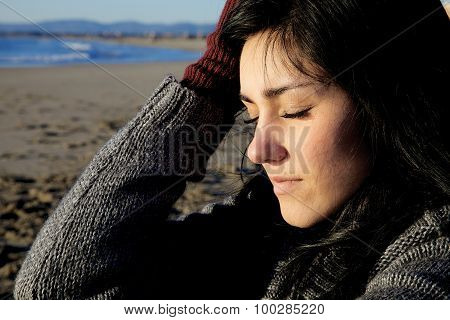 Sad Woman With Closed Eyes Feeling Pain On Beach