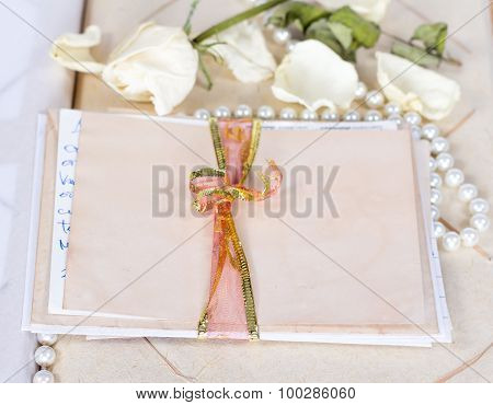 vintage envelopes, dry rose and old letters.