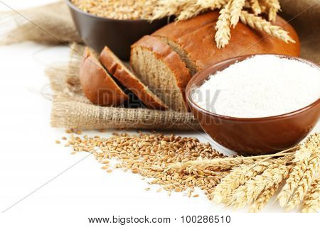 Ears Of Wheat And Bowl Of Flour On White Background