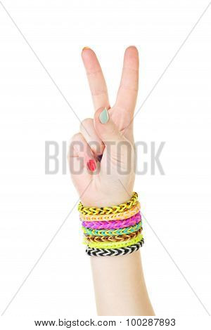 Loom Bracelets On Hand Of Young Girl