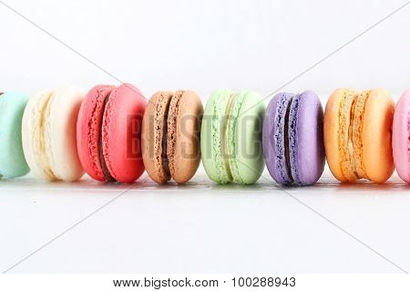 French Colorful And Tasty Macarons On Wooden Table