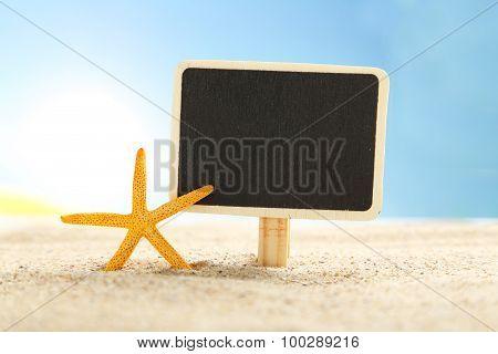 Starfish With Frame On A Beach Sand