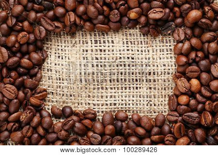 Roasted Coffee Beans Frame On A Sack, Close Up