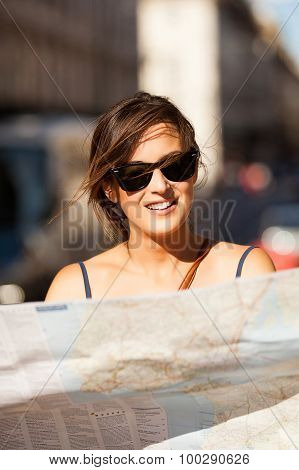Smiling Woman Consulting A Map In The Street.