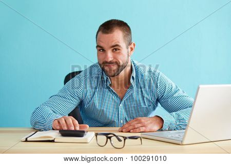 Smiling Businessman Calculates Tax