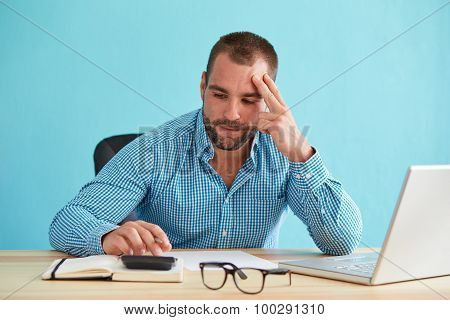 Pensive Businessman Calculates Taxes