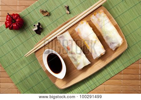 Portion Of Spring Rolls On A Bamboo Board