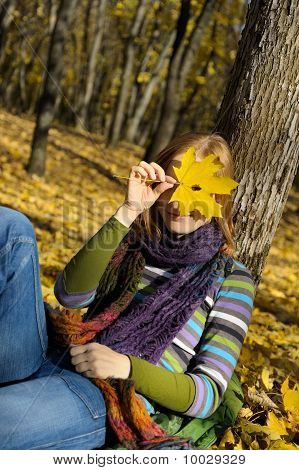 Woman And A Yellow Leaf