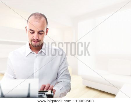 Man With Typewriter At Home