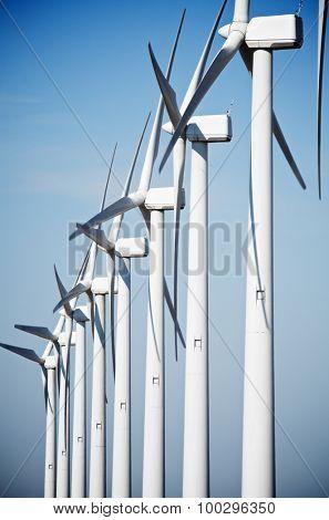 aligned group of windmills for renewable electric energy production, Cintruenigo, Navarre, Spain
