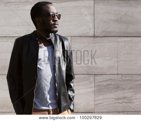 Fashion Portrait Of Stylish Young African Man Wearing A Sunglasses And Black Rock Leather Jacket Ove