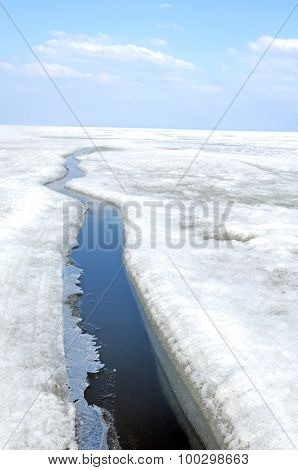 arctic solid ice landscape with track of ice-breaker ship