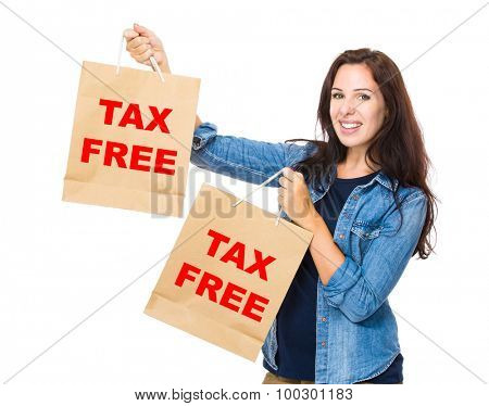 Shopping woman hold with shopping bag and showing phrase of tax free