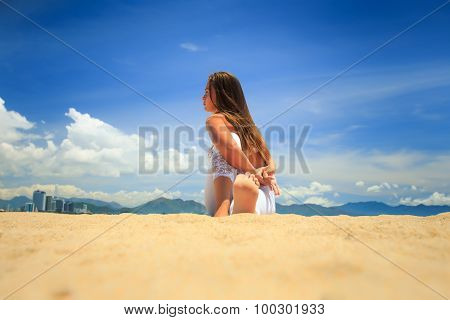 Girl In Lace In Yoga Asana Twisting Arms Behind Back On Beach