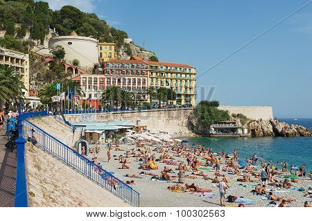 People relax at the public beach in Nice, France.