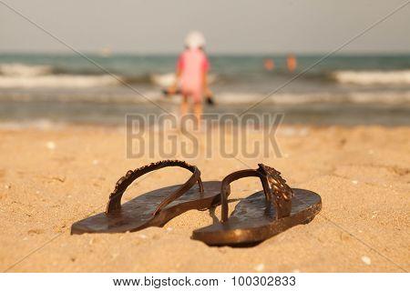 Beach slippers on sand beach of Lake Balaton