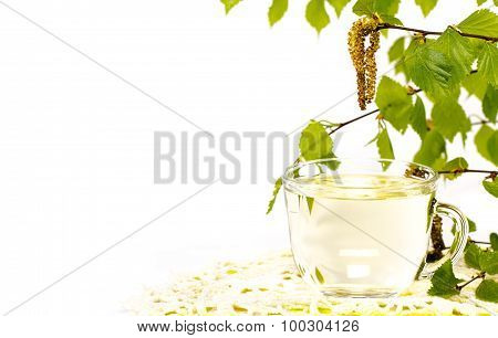 A transparent cup of birch sap on white background