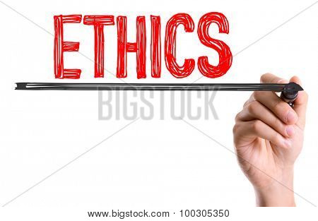 Hand with marker writing the word Ethics