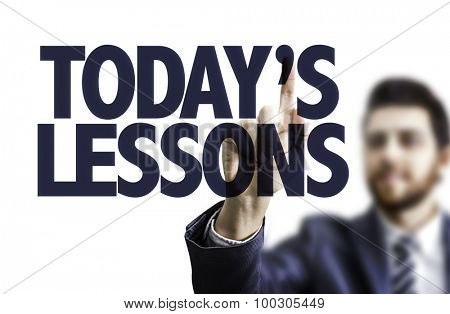 Business man pointing the text: Today's Lessons
