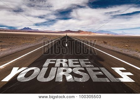 Free Yourself written on desert road