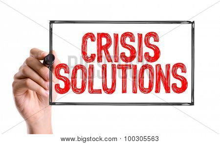 Hand with marker writing the word Crisis Solution