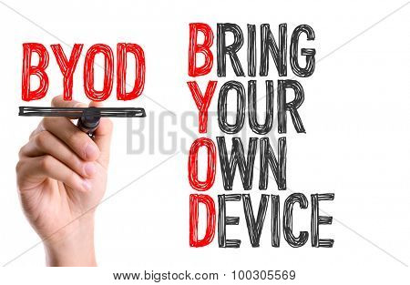Hand with marker writing the word Bring Your Own Device