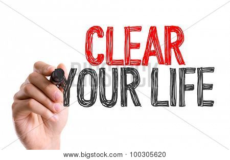 Hand with marker writing the word Clear Your Life