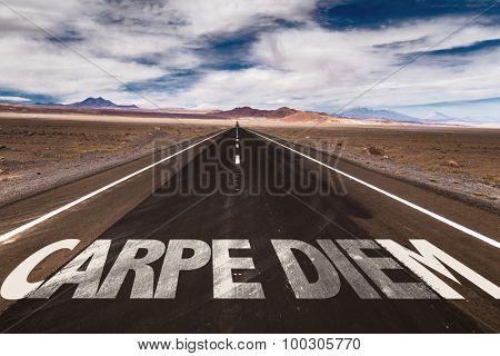 Carpe Diem written on desert road