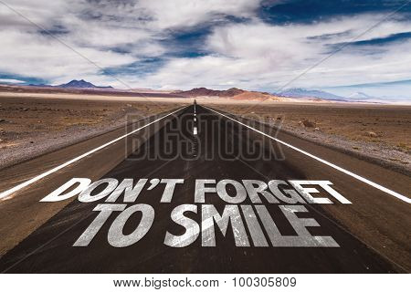Don't Forget to Smile written on desert road