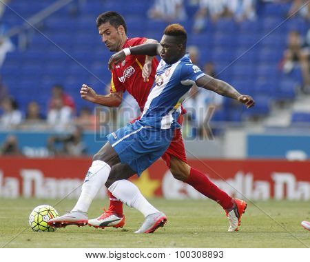 BARCELONA - AUG, 22: Felipe Caicedo(R) of Espanyol fight with Juan Rodríguez(L) of Getafe during a Spanish League match at the Power8 stadium on August 22 2015 in Barcelona Spain