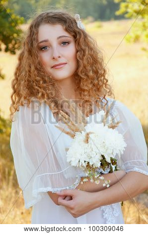 Woman With Curly Golden Hair Smiling With A Bee On Her Pupils