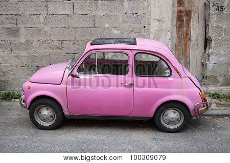 Old Pink Fiat Nuova 500 City Car, Side View