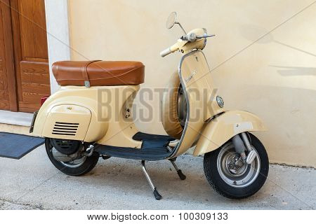 Classical Yellow Vespa Scooter Stands Parked